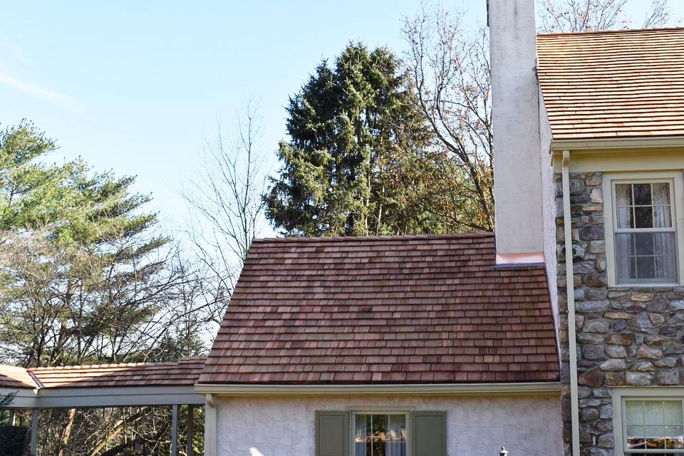 After: New cedar roof installed by A. H. Davis and Son, Inc.