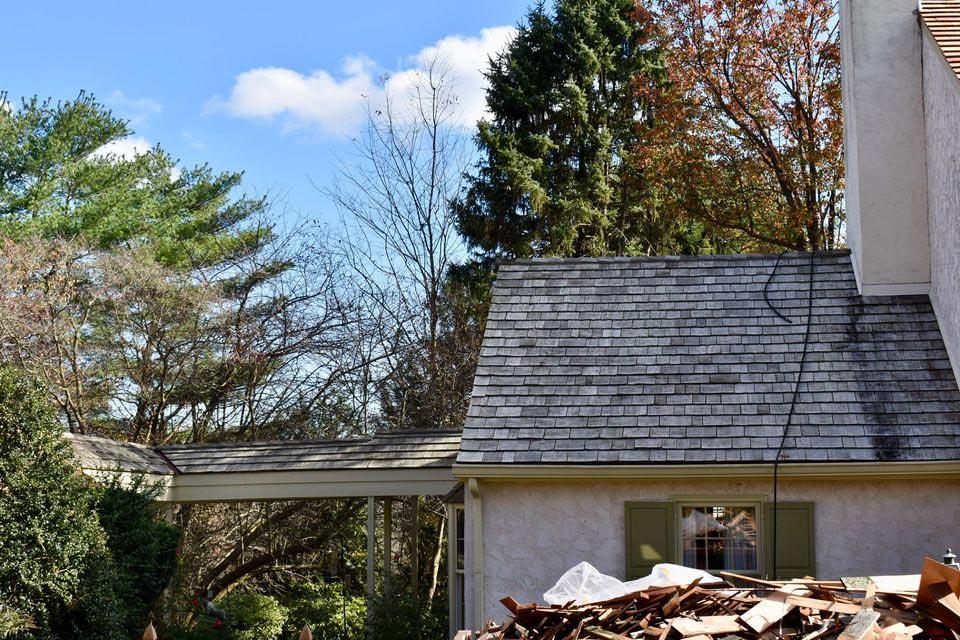Before: worn cedar roof.